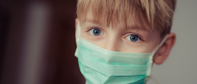 boy-wearing-surgical-mask-695954