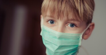 boy-wearing-surgical-mask-695954